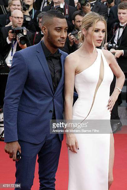Doutzen Kroes Sunnery James attend the opening ceremony and 'La Tete Haute' premiere during the 68th annual Cannes Film Festival on May 13 2015 in...