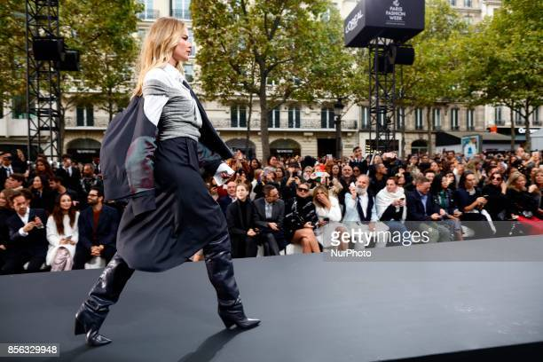 Doutzen Kroes walk the runway during the Le Defile L'Oreal Paris show as part of the Paris Fashion Week Womenswear Spring/Summer 2018 at the Champs...