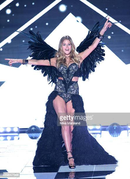 Doutzen Kroes walks the runway at the annual Victoria's Secret fashion show at Earls Court on December 2 2014 in London England