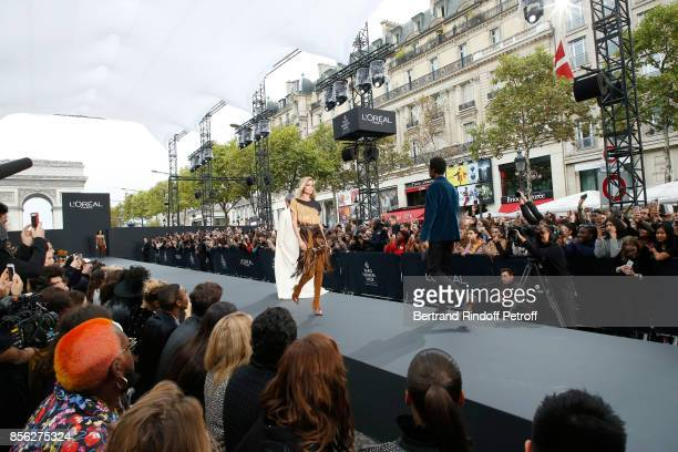 Doutzen Kroes walks the runway during 'Le Defile L'Oreal Paris show' as part of the Paris Fashion Week Womenswear Spring/Summer 2018 on October 1...