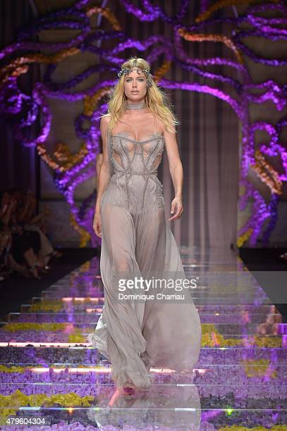 Doutzen Kroes walks the runway during the Versace show as part of Paris Fashion Week Haute Couture Fall/Winter 2015/2016 on July 5 2015 in Paris...