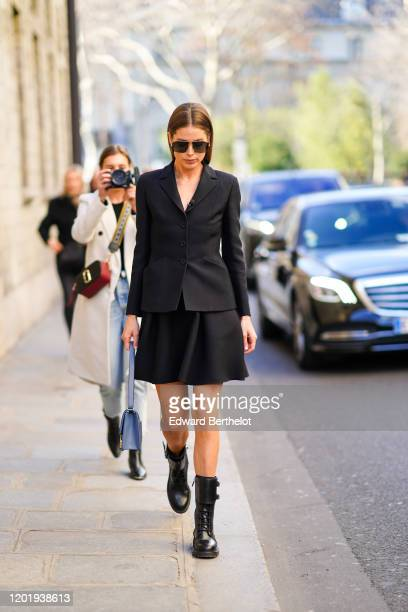 Doutzen Kroes wears sunglasses, a black blazer jacket, a skirt, black leather shoes, a blue bag, outside Dior, during Paris Fashion Week - Haute...