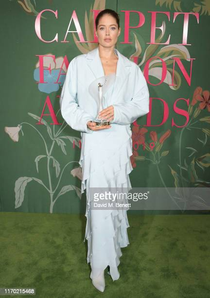 Doutzen Kroes winner of The Social Media Changemaker Award poses in the Winners Room at The Green Carpet Fashion Awards Italia 2019 hosted by CNMI...