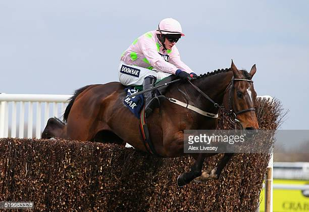 Douvan ridden by Paul Townend jumps the second last fence during their victory in the Doom Bar Maghull Novices' Steeple Chase at Aintree Racecourse...