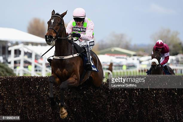 Douvan ridden by Paul Townend on their way to victory in the Doom Bar Maghulll Novices Steeple chase at Aintree Racecourse on April 9 2016 in...