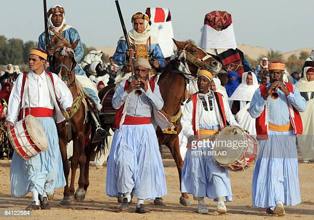 A Douz folklore group performs during the opening of the Sahara International Festival in Douz southwestern Tunisia on December 25 2008 The 41st...