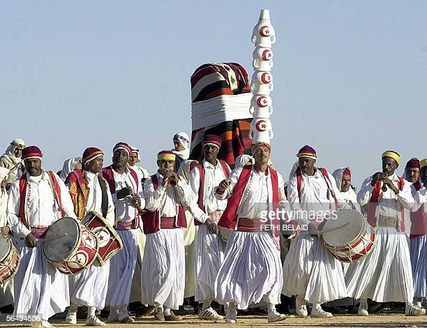 Douz' folkloric group performs 28 December 2005 during the closing of the Sahara International Festival in Douz southwestern Tunisia AFP PHOTO FETHI...