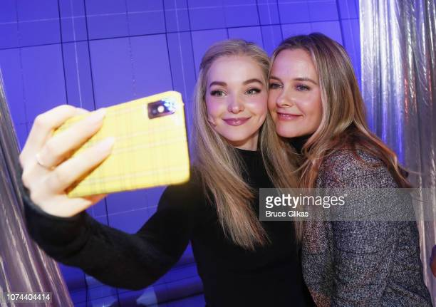 Dove Cameron and Alicia Silverstone pose for a selfie backstage at The New Group production of 'Clueless The Musical' based on the iconic 1995 film...