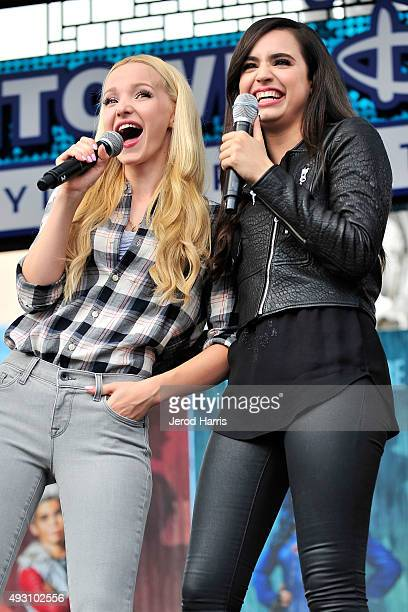 Dove Cameron and Sofia Carson of Disney's 'Descendants' perform and join fans at Downtown Disney at Disneyland Resort on October 17 2015 in Anaheim...