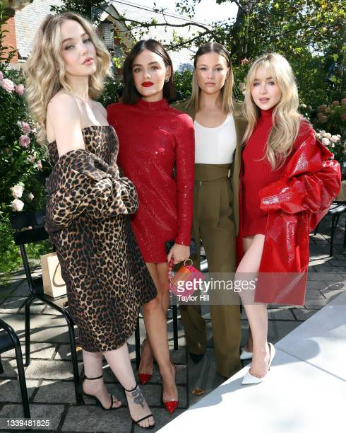 Dove Cameron, Lucy Hale, Olivia Holt, and Sabrina Carpenter attend the Michael Kors S/S 2022 show during New York Fashion Week at Tavern on the Green...