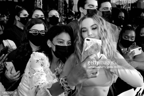 Dove Cameron poses for a selfie with fans during the 2021 MTV Video Music Awards at Barclays Center on September 12, 2021 in the Brooklyn borough of...
