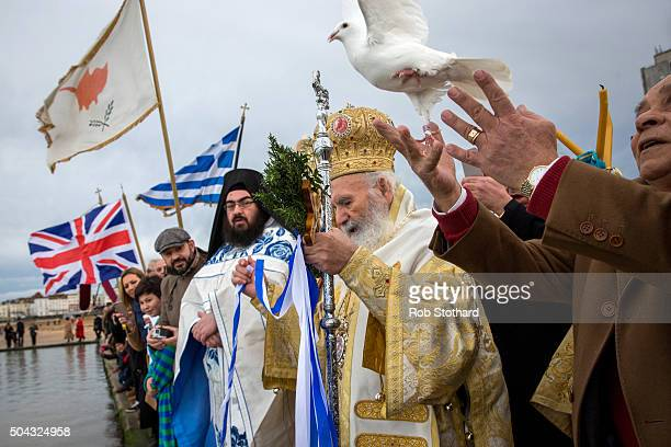 A dove is released as His Eminence Gregorios Greek Orthodox Archbishop of Thyateira and Great Britain offers a blessing at Margate beach for the...