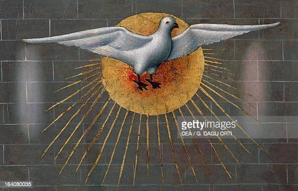 Dove on the Sun symbol of the Holy Spirit detail from the Pentecost ca 1450 from the Master of Budapest painting on wood