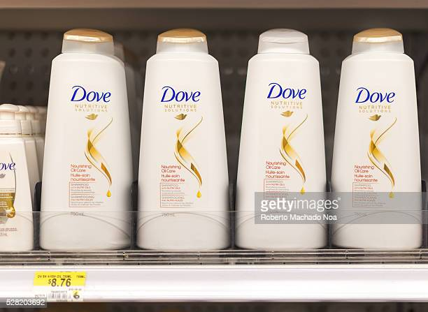 Dove shampoo and conditioner bottles in a shelf Dove is one of the most reliable brands in cosmetic products