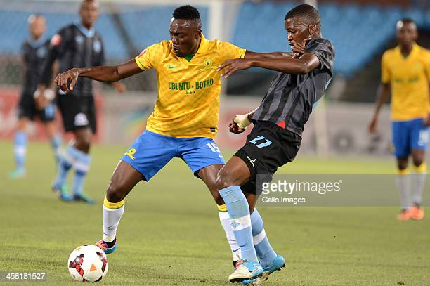 Dove Wome of Sundowns and Thamsanqa Mkhize of Maritzburg in action during the Absa Premiership match between Mamelodi Sundowns and Maritzburg United...