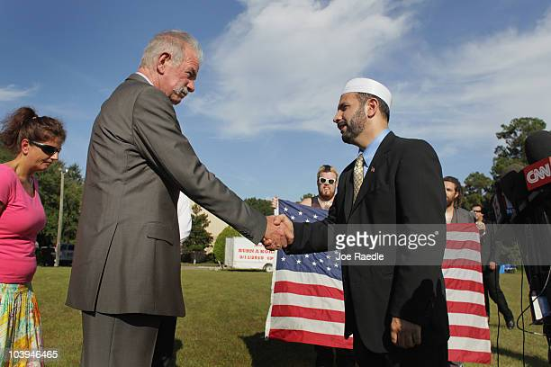 Dove World Outreach Center pastor Terry Jones shakes hands with Imam Muhammad Musri president of the Islamic Society of Central Florida in Orlando...