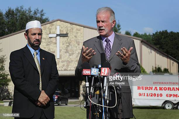 Dove World Outreach Center pastor Terry Jones speaks to the media as Imam Muhammad Musri president of the Islamic Society of Central Florida in...