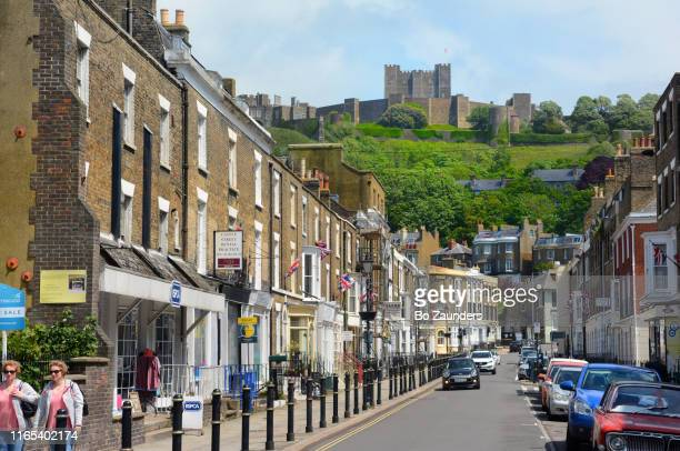 dover castle, the largest fortress in england, founded about a thousand yars ago, as seen from castle street in dover, uk. - bo zaunders stock pictures, royalty-free photos & images