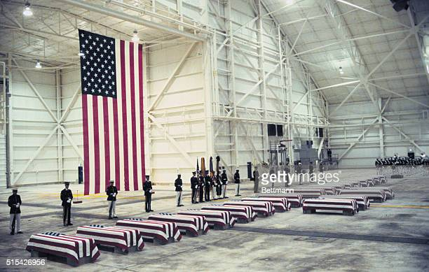 Honor guardsmen stand near the flagdraped coffins of 22 United States servicemen 15 who were killed in the Beirut bombing and seven who were killed...