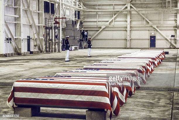 Dover Delawre At precisely 7 AM a Marine honor guard and a color guard in ceremonial dress uniforms marched into a huge hangar at the Dover Air Force...