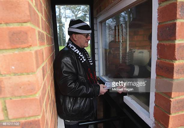 Dover fan enters through the turnstiles prior to the FA Cup Third Round match between Dover Athletic and Crystal Palace at Crabble Athletic Ground on...