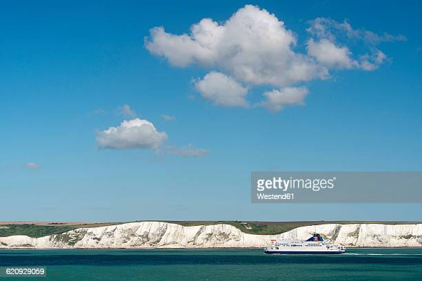 UK, Dover, ferry in front of chalk cliffs