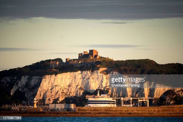 Dover ferry terminal and Dover Castle are illuminated by the rising sun on September 06 2020 in Dover England The English Channel is one of the...