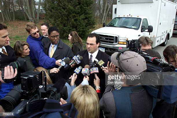 Dover Township Deputy Mayor Carmine Inteso Jr briefs the news media at the scene where 5 people were shot to death April 10 2002 in Toms River NJ The...