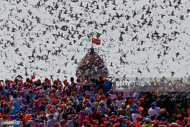 Doves are released as a crowd looks up during a military parade marking the 70th Anniversary of the 'Victory of Chinese People's Resistance against...
