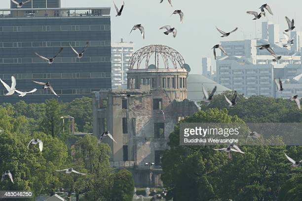 Doves are released as a sign of peace during the Hiroshima Peace Memorial Ceremony at the Hiroshima Peace Memorial Park on the day of the 70th...