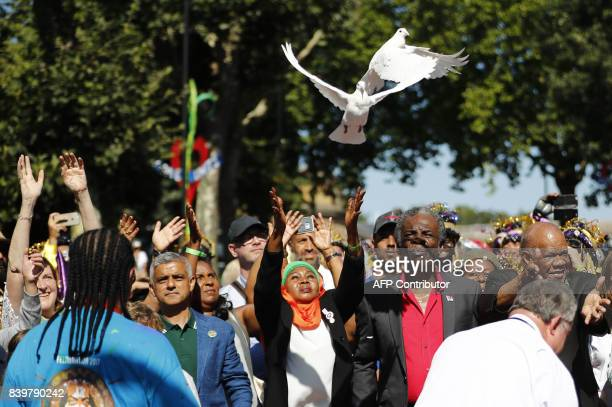 Doves are released as the victims of the Grenfell tradegy are commemorated during the opening ceremony of the Notting Hill Carnival in west London on...