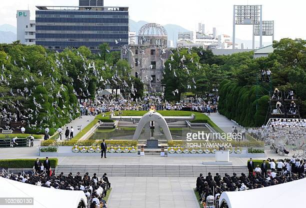 Doves fly around the Atomic Bomb Dome at the Peace Memorial Park after their release during the memorial ceremony in Hiroshima on August 6 2010 The...