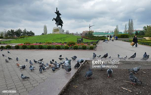 Doves gather on a square with a monument of Generalissimo of the Russian Empire Alexander Suvorov in Tiraspol the capital of Transdniestr separatist...