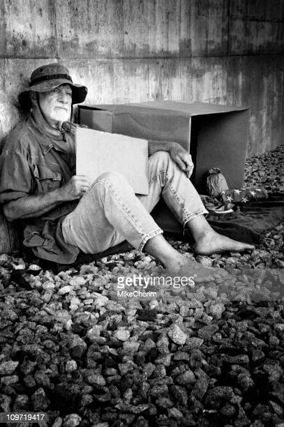down and out vietnam vet holding a blank sign - homeless veterans stock photos and pictures