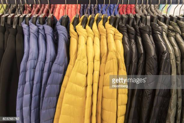Down jackets hang on display inside the Bosideng International Holdings Ltd. Flagship clothing store in Shanghai, China, on Friday, July 14, 2017....