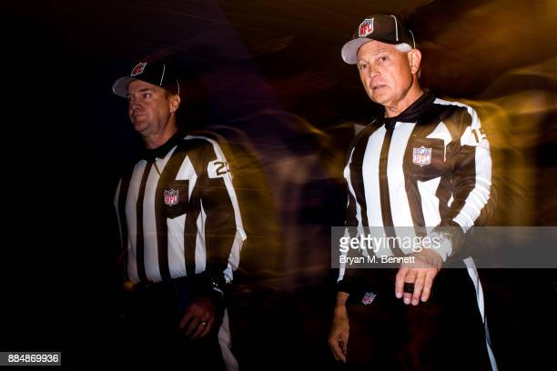 Down judge David Oliver and field judge Rick Patterson walk to the field before a game between the Buffalo Bills and New England Patriots on December...