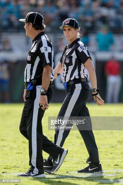 Down Judge Sarah Thomas talks with NFL Side Judge Scott Edwards during the game between the Los Angeles Chargers and the Jacksonville Jaguars on...
