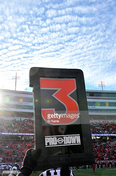 Down marker shows third down during the game between the North Carolina State Wolfpack and the Maryland Terrapins at Carter-Finley Stadium on...
