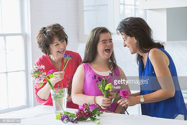Down syndrome girl, mother, grandma flower arranging