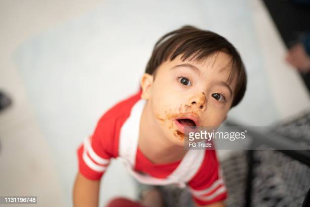Down Syndrome Little Boy with Chocolate Face Portrait