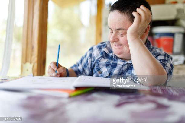 down syndrome woman drawing - intellectually disabled stock pictures, royalty-free photos & images