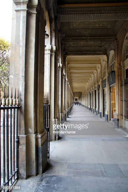 down the long corridor - palais royal stock pictures, royalty-free photos & images
