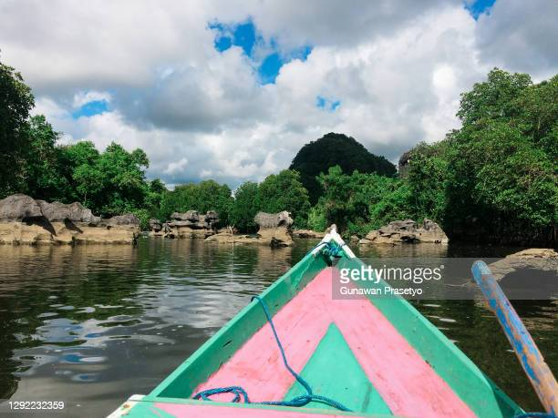 down the river by boat - makassar stock pictures, royalty-free photos & images