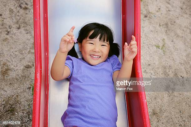 down the slide - yonago stock photos and pictures