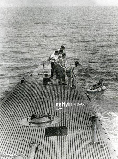 Downed pilot LTJG George Bush is rescued by the Navy submarine USS Finback on September 2 1944