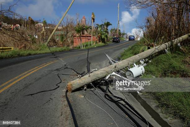 Downed power and utility lines continue to block roads more than a week after Hurricane Irma made landfall on September 18 2017 in the hills above...