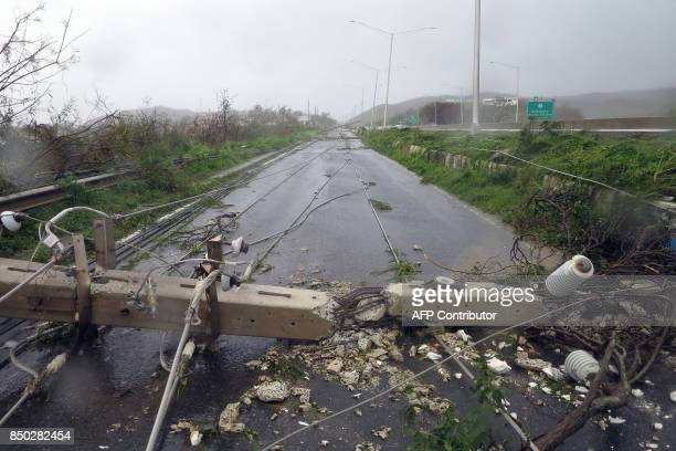 Downed power line poles are seen as Hurricane Maria hits Puerto Rico in Fajardo on September 20 2017 Maria made landfall on Puerto Rico pummeling the...