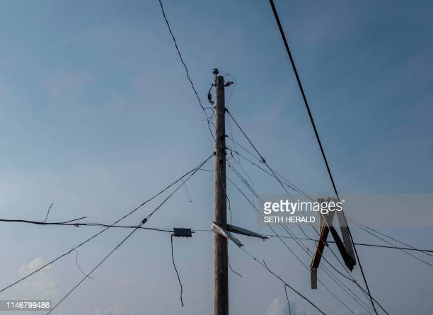 Downed power lines are seen in Dayton Ohio on May 28 after powerful tornadoes ripped through the US state overnight causing at least one fatality and...