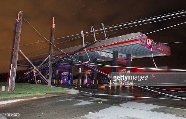 Downed power lines kept some people trapped in a Quiktrip in Wichita Kansas on Saturday April 14 after a tornado caused massive destruction in the...