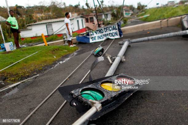 Downed traffic lights and power lines are seen in the aftermath of Hurricane Maria in Luquillo Puerto Rico Thursday September 21 2017 Puerto Rico...